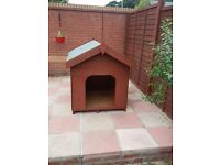 Large wooden dog kennel house