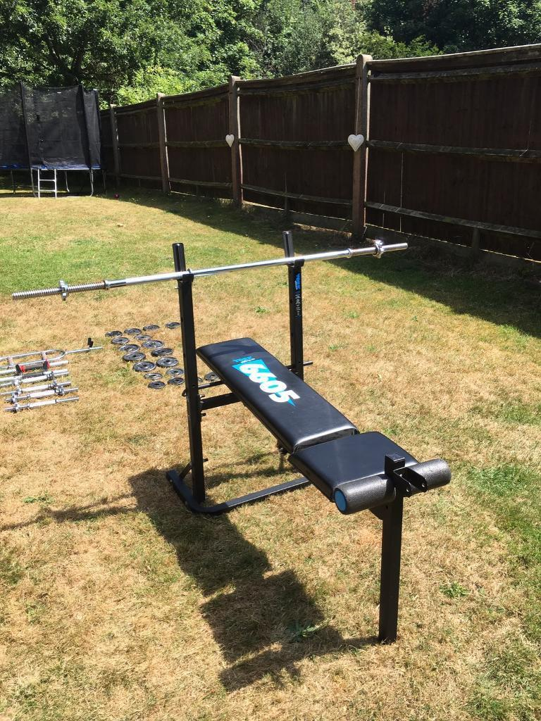 SOLD. York bench press/ weights bench and 22kg weight assortment.