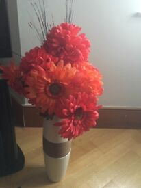 Red faux Flowers and vase