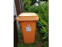 Large orange wheelie bin