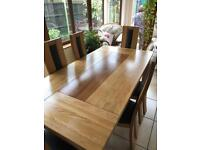 Two colour solid wood dining table and six wood and leather chairs
