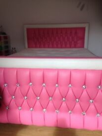 girls pink and white faux leather bed with diamanté detail.