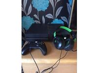 Xbox one 1tb, wireless control, turtle Beach head set, and games