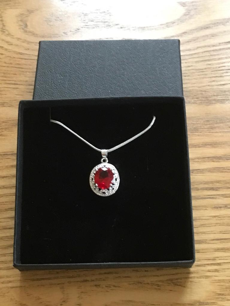 Ladies silver pendant and chain with a red stone new