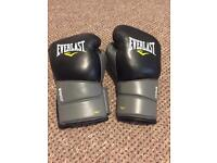 16oz Boxing gloves and pads, basically new