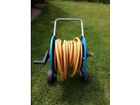 Blue/yellow garden hose with reel