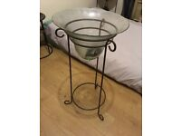 Large glass bell vase in metal stand