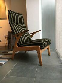 Danish 1970's upholstered wood frame armchair with integral footrest