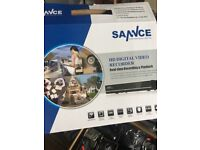 Sercurity cameras brand new in box with 4 cameras and the hardrive everything included