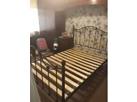 Double black metal bed frame complete with slats
