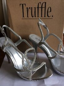 Ladies size 5 silver strappy high heels