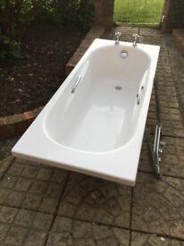 Used white fiberglass bath inc taps, waste & support frame