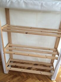 Pine shelving unit with canvas cover