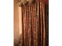 Fully lined and trained peach / green / red patterned curtains