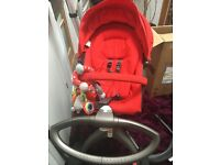 Stokke xplory pram in red.