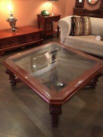 Fabulous large wood and glass decorative legs coffee table