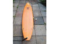 7 foot 6 ten toes over surfboard