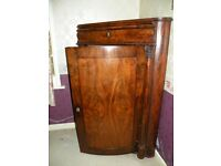 A magnificent waulnut veneer corner cupboard believed to be early 18th century