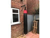 Punch bag with mounting bracket and a set of gloves