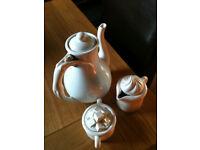 Tea pot, milk jug and sugar bowl by company of friends 1979