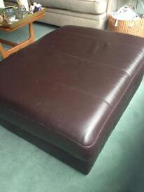 Large brown leather footstool