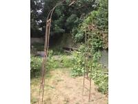 Wrought iron decorative garden arch or plant climber
