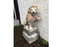 A pair of solid stone garden Lions.