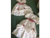 2 bridesmaids or dressing up dresses. Cream silk with underskirt attached, pink trim.
