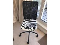 Black and white swivel chair