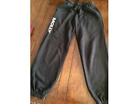 Black tracksuit bottoms with the name 'Molly' on the front