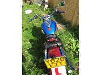 Suzuki VL 125 intruder Custom Superman theme motorcycle