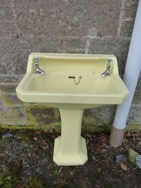 Basin with pedestal and taps