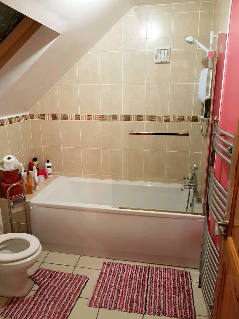 Full bathroom suite, bath toilet sink taps shower over bath and ...