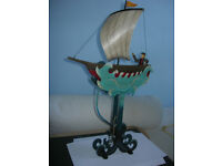 Boat sailing the waves with sailor at helm: swinging painted metal ornament toy. Good as new in box