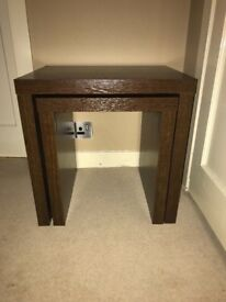 Set of Next nest of 2 tables dark brown wood selling together with a book shelf.