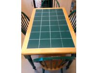 kitchen table+ 4 chairs, 1 tile cracked on table