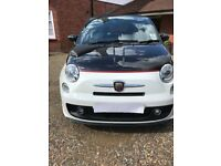 A beautiful Fiat Abarth 500C with only 15902 miles in stunning white and black with full history