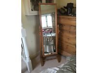 Pine swivel bedroom mirror on a stand in good condition.