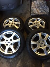 Genuine Ford Focus 6 spoke set of 4 alloy wheels 3 very good tyres fits 98-05