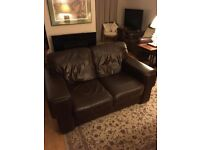Lovely 2 seater leather brown sofa