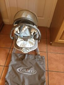 A baby bouncer that plays music or can vibrate slightly-Graco
