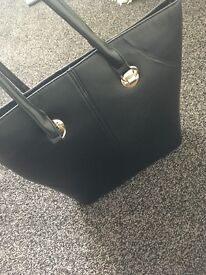Black large back, gold details