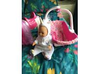 zapf baby born doll in carry seat. /unicorn. new condition
