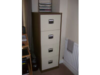 brown and beige four drawer metal filing cabinet