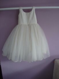 Two ivory childrens bridesmaid/occasion dresses size 2 and 4 yrs