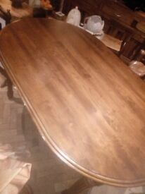 Oval dinning table, approx about 4 ft, by 3ft,