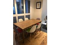 Vintage oak dining table and 6 Eames inspired dining chairs