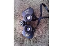 2 PAIRS OF BINOCULARS BOTH ARE IN CARRY CASES
