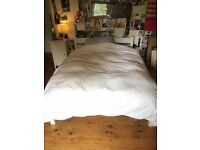 Simple painted wooden frame double bed with good quality John Lewis mattress