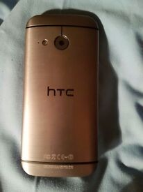 HTC mini one 16 gb o2 phone silver back, like new, comes in box with charger